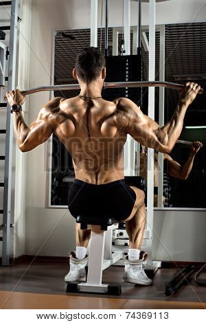 poster of very power athletic guy bodybuilder execute exercise with gym apparatus on broadest muscle of back