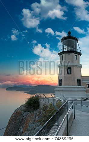 Split Rock Lighthouse Sunset with Moon in Two Harbors Minnesota poster