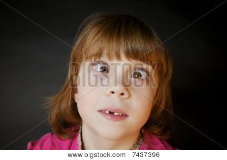 Cross Eyed Little Girl with Red Hair