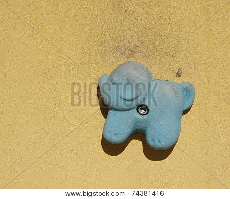 Climbing hold with shape of dog on artificial climbing wall poster