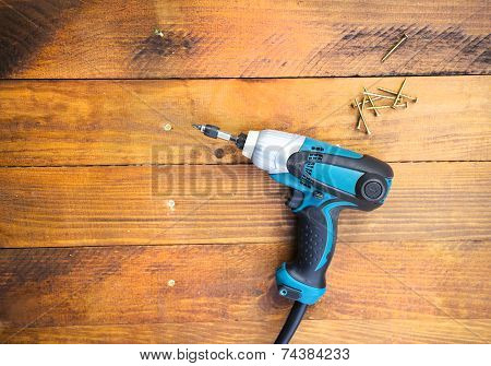 Drill left on wooden floor