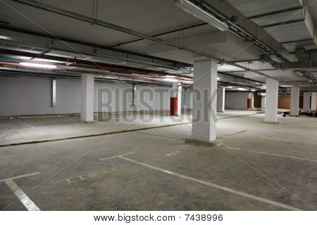 Parking place building. Empty premise with marking for cars.