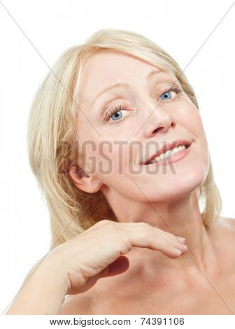 closeup portrait of attractive  caucasian smiling woman blond old mature riffles isolated on white studio shot lips toothy smile face hair head and shoulders looking at camera tooth