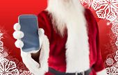 Santa claus showing smartphone against christmas themed snow flake frame poster