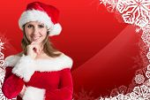 Pretty girl in santa outfit against christmas themed snow flake frame poster