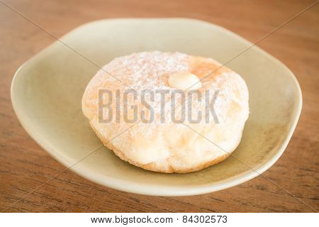 Cream Donut On Vintage Background