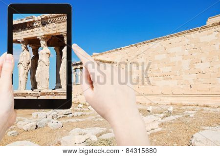 Tourist Taking Photo Of Caryatids At Acropolis