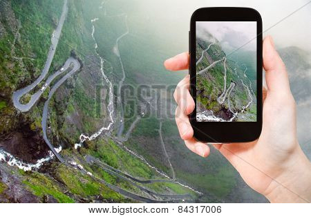 Tourist Taking Photo Of Trollstigen