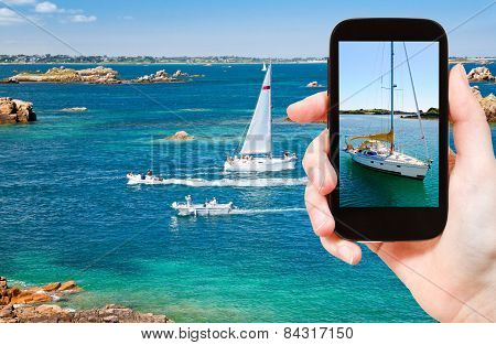 Tourist Taking Photo Of Yacht Near Brittany