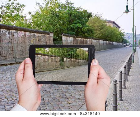 Tourist Taking Photo Of Berlin Wall