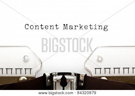 Content Marketing typed on white paper on old typewriter. poster