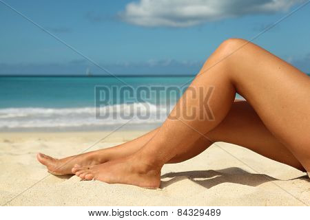 Tanned Legs On The Beach