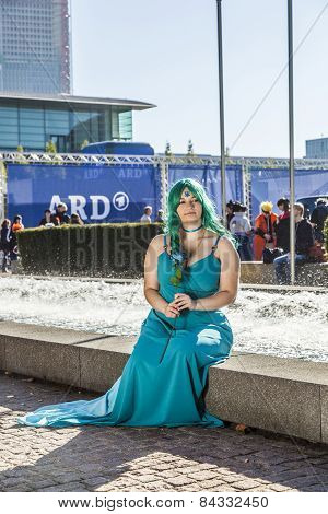 Colorful Girl Made Up As Manga From The Comic Scene Poses For Photografers