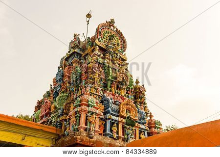 Magnificent colourful Gopuram of Shiva temple on a blue sky background