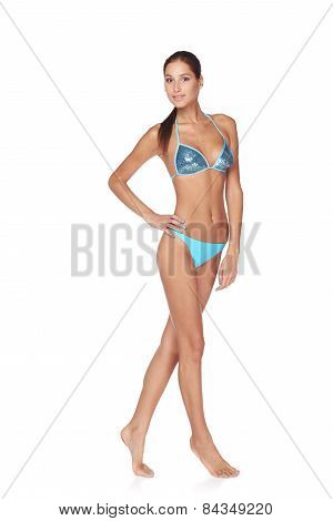 Full length beautiful slim tanned woman in blue bikini, isolated on white background poster