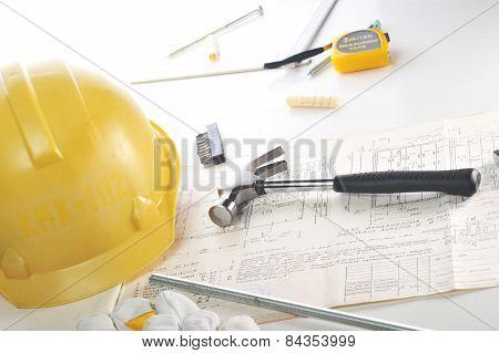Yellow Hardhat On Drawings