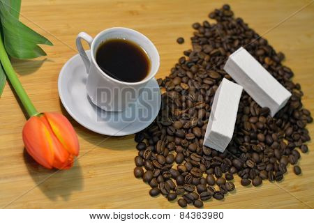 Coffee In A Cup And Coffee Beans With A Fresh Tulip And Marshmellow