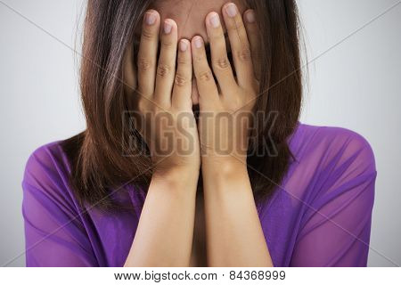 Playful shy woman hiding face laughing timid. Cute Thailand Asian / Caucasian woman smiling happy through hands. poster