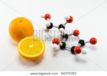 Orange and vitamin C structure model (Ascorbic acid) on white background for education poster