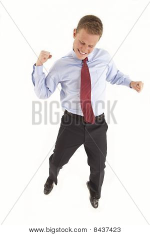 Young businessman jumping and celebrating