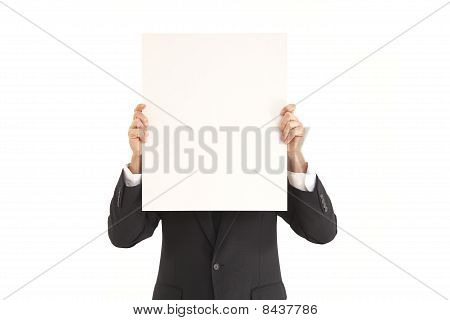 Businessman holding blank poster sign