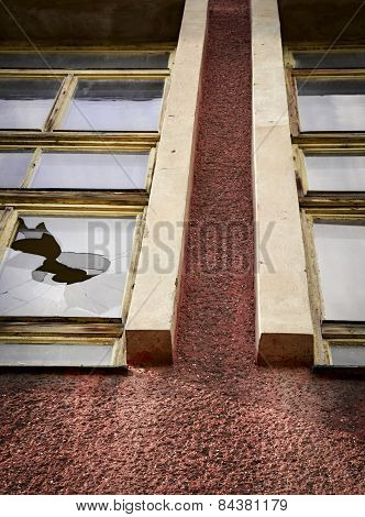The Broken Glass Window