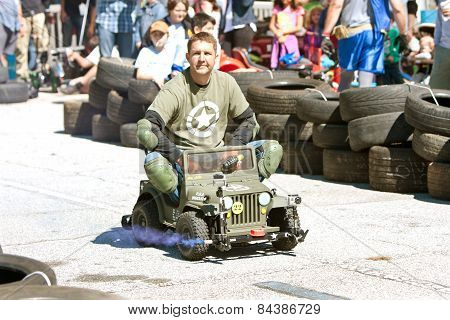 Man Races Miniature Army Jeep At Fair