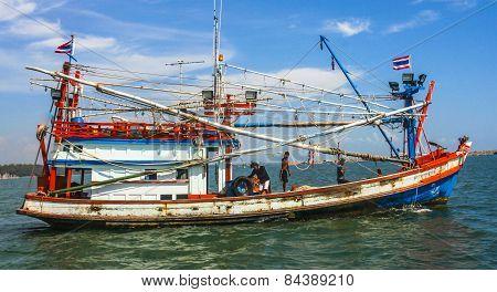 fishermen at the boat
