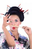 Young woman in Japanese kimono with chopsticks and sushi roll, isolated on white background. poster