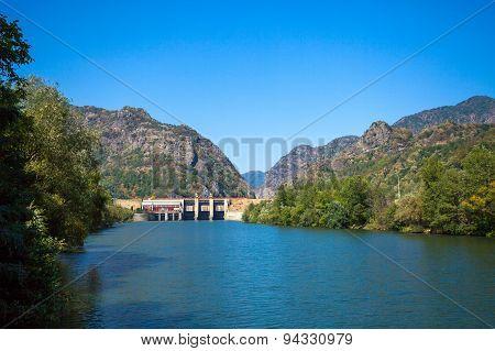Dam Built On Olt River On A Sunny Summer Day