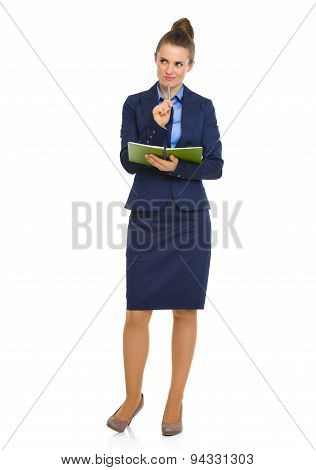Elegant Businesswoman Holding Notebook With Pen On Chin
