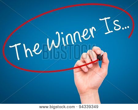 Man Hand writing The Winner Is... with black marker on visual screen.