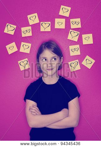 Instagram girl with sticky notes hearts around her head representing her thoughts of love