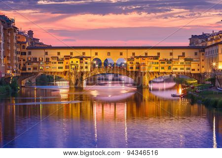 River Arno and famous bridge Ponte Vecchio at sunset from Ponte alle Grazie in Florence, Tuscany, Italy poster