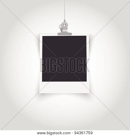 Empty polaroid frame with bulldog clip