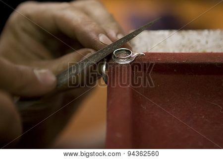 VARANASI INDIA: Unidentified Jeweler Making Jewelry (ring). Handwork. May  2015 in Varanasi India. poster