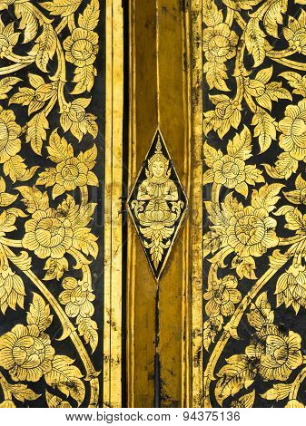 Thai classic art on temple door at Wat Rakhangkhositraram Bangkok Thailand. This use the gilding gold leave on the black lacquer method. poster