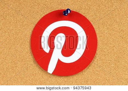 KIEV UKRAINE - MAY 25 2015:Pinterest logotype printed on paper and pinned on cork bulletin board