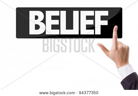 Businessman pressing button with the text: Belief