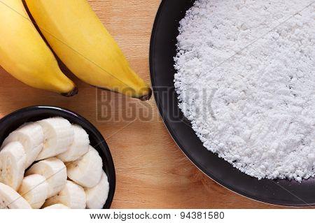 Casabe (bammy beiju bob biju) - flatbread made from cassava (tapioca) with banana on pan. Selective focus poster