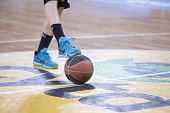 THESSALONIKI GREECE JUN 17 2015: Close-up of a baskeball on the ground during the Greek Basket League game Aris vs Paok poster