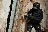 Military industry. Special forces or anti-terrorist police soldier,  private military contractor armed with weapon during clean-up operation, mission poster