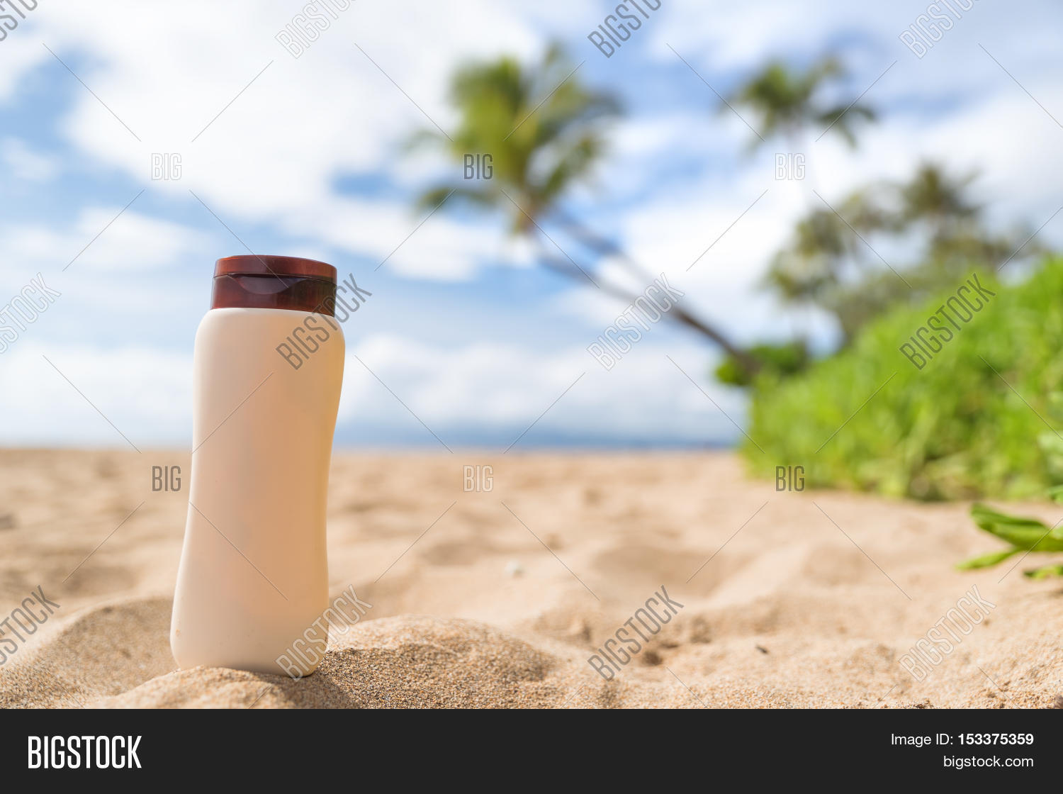 Blank Sunscreen Sun Lotion Bottle Lying In Golden Sand On Hawaii Beach Vacation Tropical Background