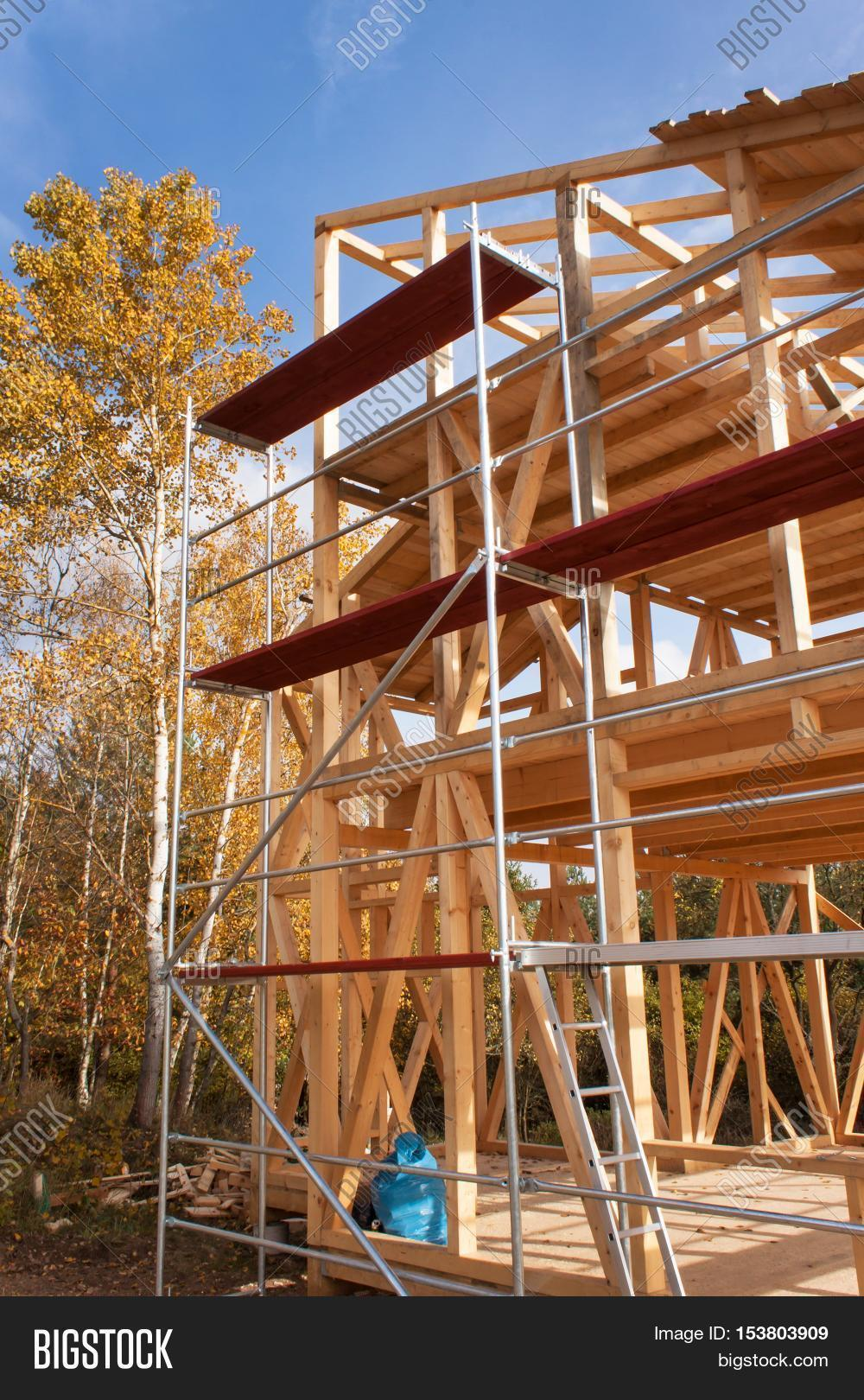 Metal scaffolding around unfinished image photo bigstock for Process of building a new house