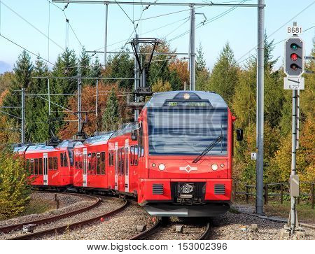 Zurich, Switzerland - 22 October, 2016: a train arriving to the station on the Mt. Uetliberg. Uetliberg is a mountain rising to 869 m, from its top one can enjoy a panoramic view on the entire city of Zurich and the Lake of Zurich.