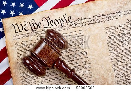 Bill of rights we the people with wooden gavel and American flag.
