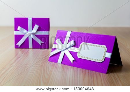 Group of multicolored boxes on a wooden background