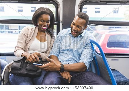 Happy Black Couple Travelling By Bus In Chicago