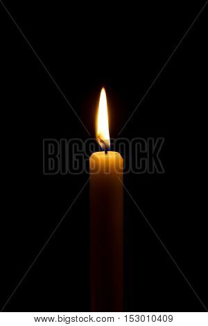 burning candlelight in a church over black background.