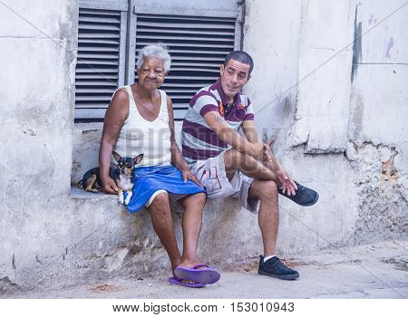 HAVANA CUBA - JULY 18 : Cuban people in old Havana street on July 18 2016. The historic center of Havana is UNESCO World Heritage Site since 1982.